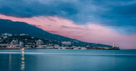 Sunrise over rocky black sea coastline. Black sea, Yalta, Ukraine photo