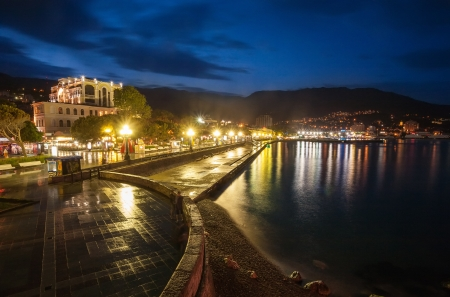 Night city near sea. Ukraine, Black sea, Yalta photo