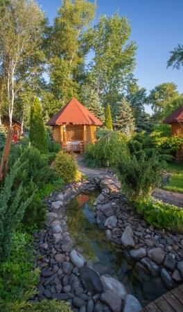 Gazebo in landscaped garden with interlocking stone patio