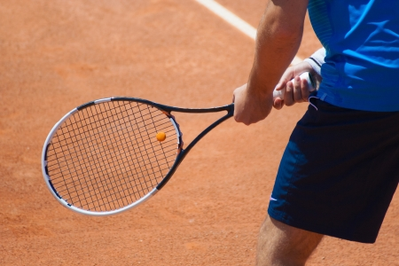 tennis player: A tennis player waiting for a serve during a match