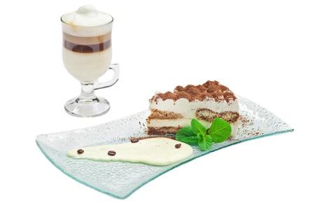 Cake tiramisu and a cup of hot coffee photo