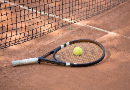 Close up view of tennis racket and balls on the clay tennis court Stock Photo - 20758120