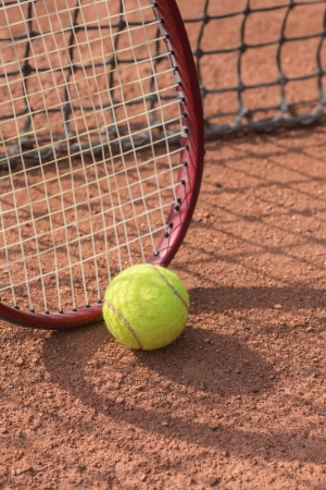 Close up view of tennis racket and balls on the clay tennis court Stock Photo - 20758125