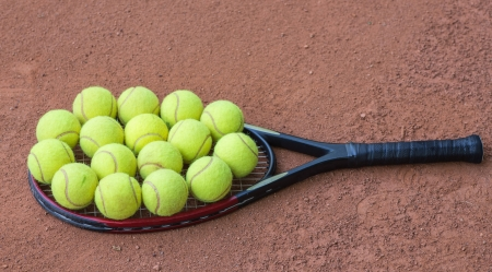 Close up view of tennis racket and balls on the clay tennis court Stock Photo - 20758132