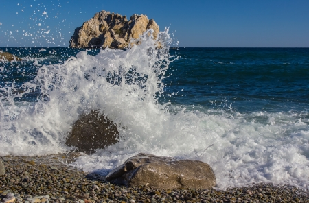 roaring sea: The waves breaking on rock, forming a spray Stock Photo