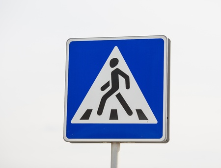 Pedestrian transit traffic sign over the sky photo