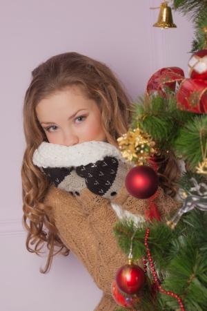 Beautiful girl hanging toy on Christmas tree Stock Photo - 23667165