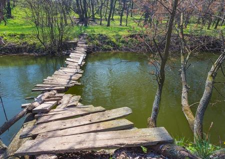 landscape with a wooden bridge over the river Standard-Bild