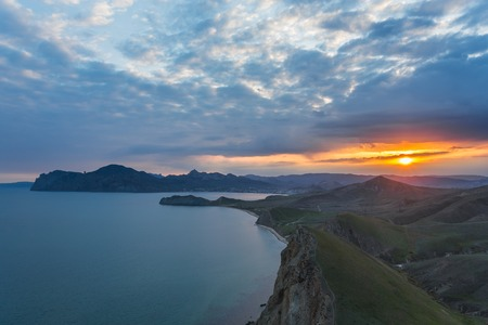 Ancient volcano Karadag at sunset in Crimea photo