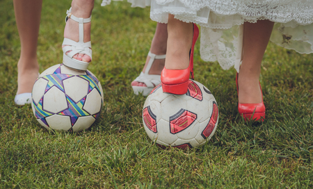 wedding shoes bride and her bridesmaids on a soccer ball photo