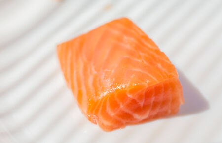 Three pieces of salmon on cutting board photo