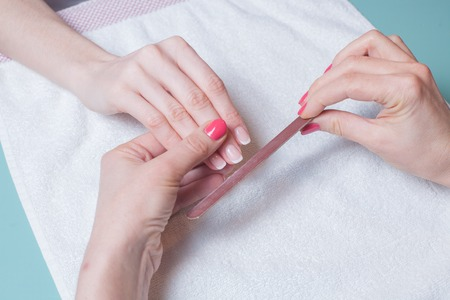 Gentle care of nails in a beauty salon photo