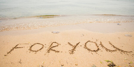 For you written in the sand on the beach. photo