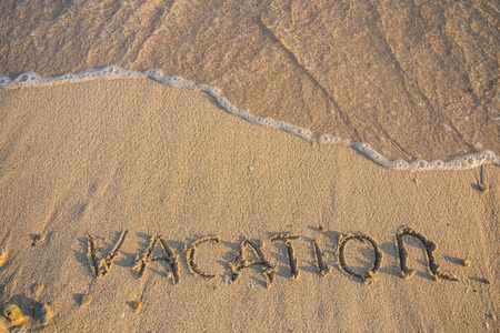 vocation: Word Vocation write on white sand beach