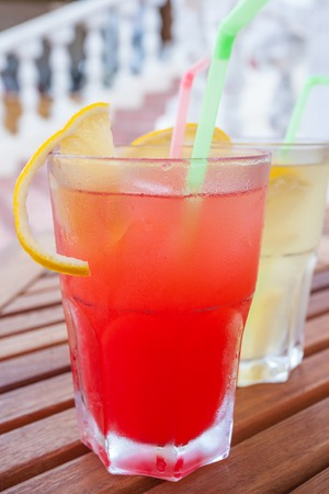 red and yellow cocktail photo