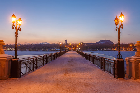 Bridge city landscape in snowy winter night photo