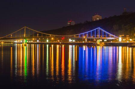 kiev: Foot bridge in Kiev at night. Ukraine. Stock Photo
