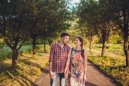 Couple walking holding hands in a park - Romantic date outdoors Stock Photo