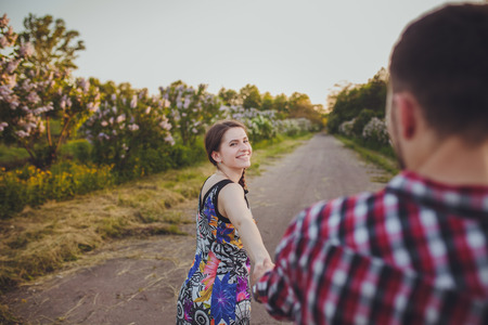 woman outdoor: a young couple in love walking in the woods Stock Photo