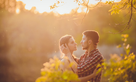 couple in love: a young couple in love walking in the woods Stock Photo