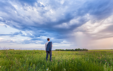businessman thinking: businessman is working and relaxing in the nature. Stock Photo