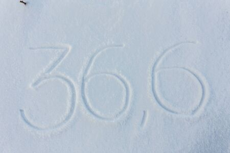 36 6: The word 36,6 draw on snow background