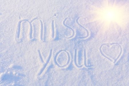 Miss you greetings written on white snow stock photo picture and miss you greetings written on white snow stock photo 47805092 m4hsunfo