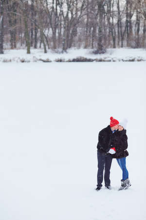 wintery day: Young  happy smiling couple in love. Winter Stock Photo