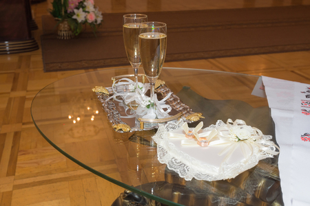 onsite: Table for wedding ceremony on-site caravans towel beautiful glasses of champagne, decorated with beautiful flowers, wedding decoration and floristry