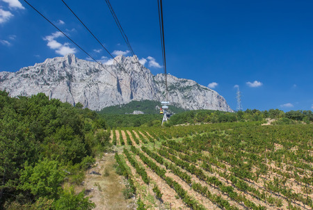 top down car: The cable car in Crimea Ai-Petri on a background of mountains covered with clouds