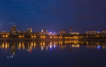 donetsk: Night city reflection on the river in Donetsk. Ukraine Stock Photo