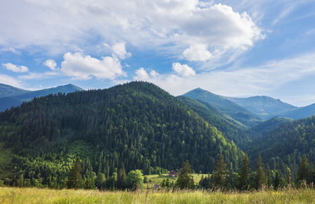 cascade range: Summer landscape in mountains and the dark blue sky with clouds