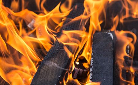calorific: Wood burning in the fire - a square background