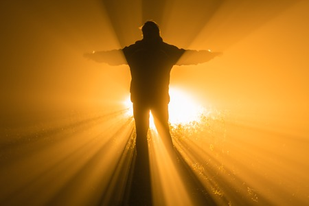 torchlight: man with a torch at night in fog