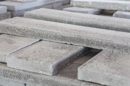 Stack of precast reinforced concrete slabs in a house-building factory Standard-Bild