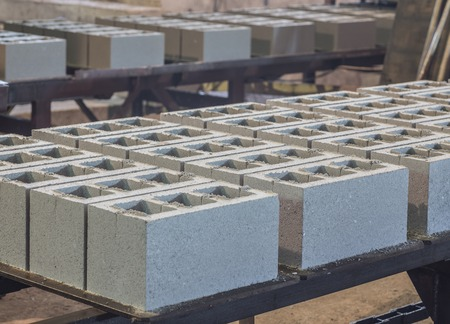 precast: Stack of precast reinforced concrete slabs in a house-building factory Stock Photo