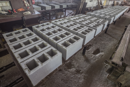 reinforced: Stack of precast reinforced concrete slabs in a house-building factory Stock Photo