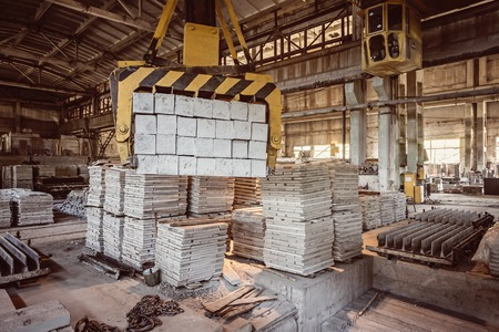 housebuilding: Stack of precast reinforced concrete slabs in a house-building factory Stock Photo