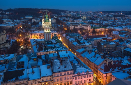 Winter view on the downtown in Lviv, Ukraine. Old buildings. Roofs covered by snow