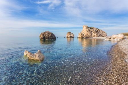 tou: Seascape with Petra tou Romiou, also known as Aphrodites Rock, is a sea stack in Pafos, Cyprus. Stock Photo