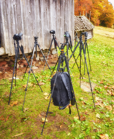A lot of tripods without cameras are waiting for the shooting