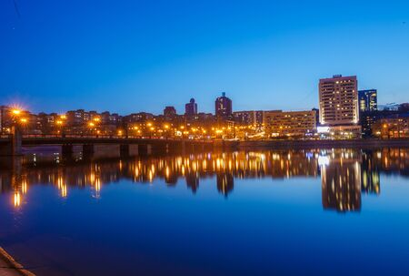 Night city reflection on the river in Donetsk. Ukraine Stock Photo