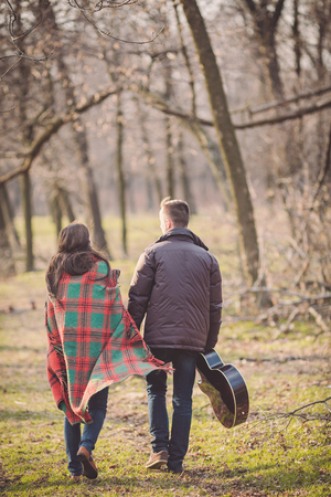 sad young couple in autumn park together Stock Photo