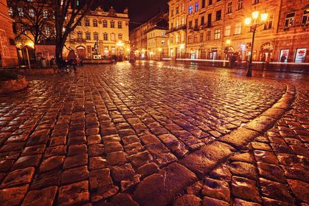 city night street paving stone bench, nobody