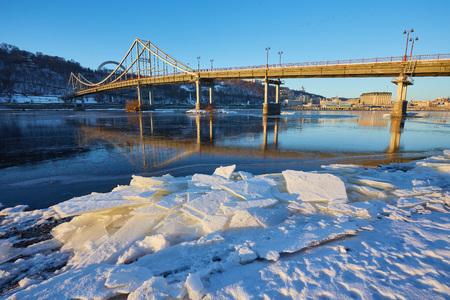 Frosty morning at the river near the bridge. Kiev, Ukraine Stock Photo