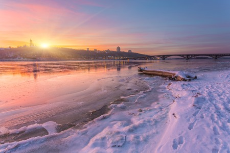 Bright sunset over the river Dnieper on winter