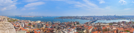 Panoramic Golden Horn sunset view with Blue Mosque and Hagia Sophia from Galata tower, Istanbul, Turkey Stock Photo