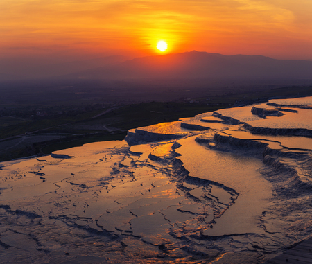 Travertine pools and terraces in Pamukkale, Turkey in sunset time Stock Photo