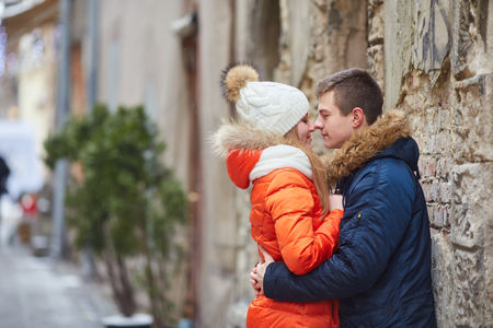 Young happy couple in love outdoors. loving man and woman on a walk in the city