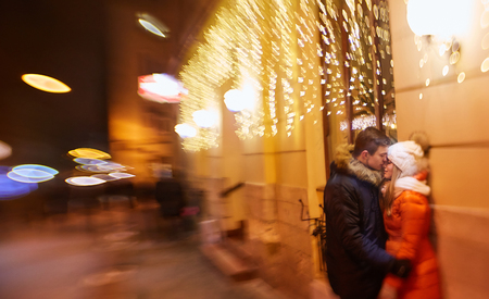 Young happy couple in love outdoors. loving man and woman on a walk in the city. Selective focus effect